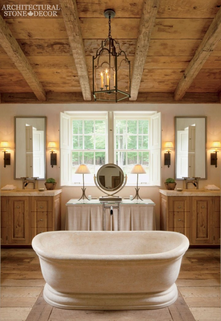 French country bathroom reclaimed hand-carved limestone bath tub wood ceiling