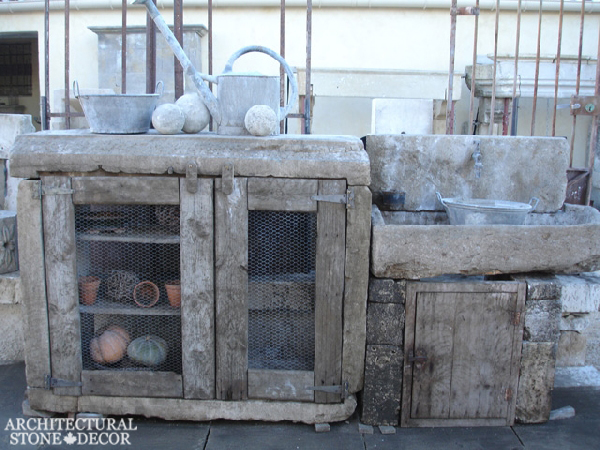 Outdoor kitchen with reclaimed limestone sink