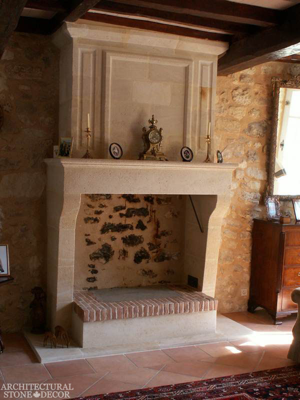 French-country-style-home-villa-living-room-reclaimed-limestone-handcarved-fireplace-mantel-canada-architectural-stone-decor-interior-design-2