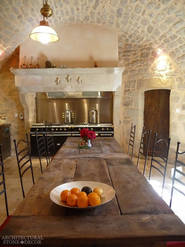 Farmhouse kitchen with limestone table and limestone kitchen hood