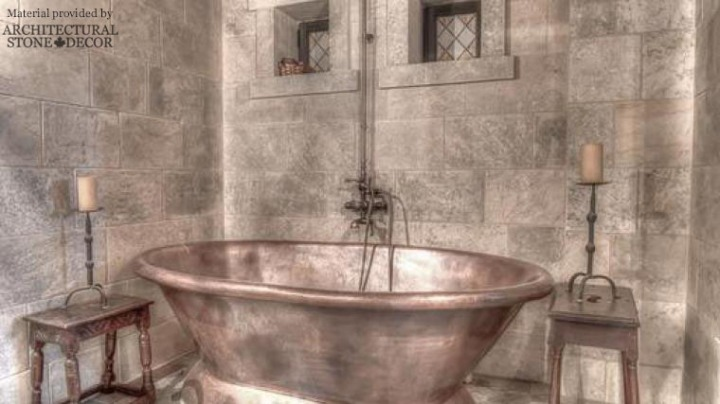 Medieval bathroom reclaimed limestone wall cladding niches copper bathtub