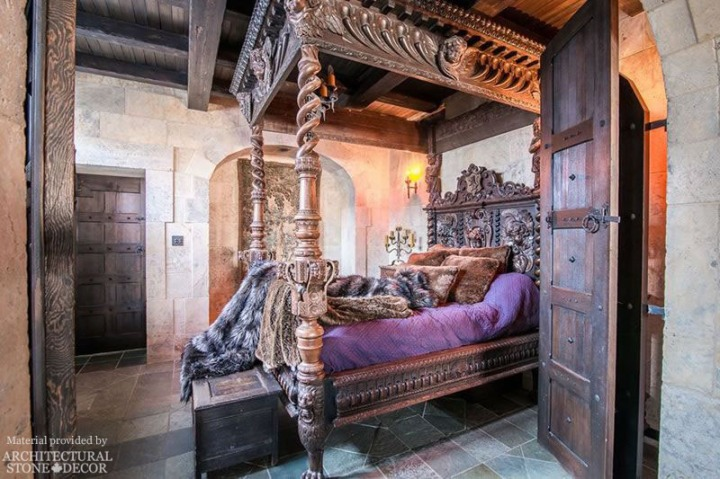 King's Landing Red Keep Medieval Game of Thrones bedroom with reclaimed limestone flooring and wall cladding and rustic wood doors and beams