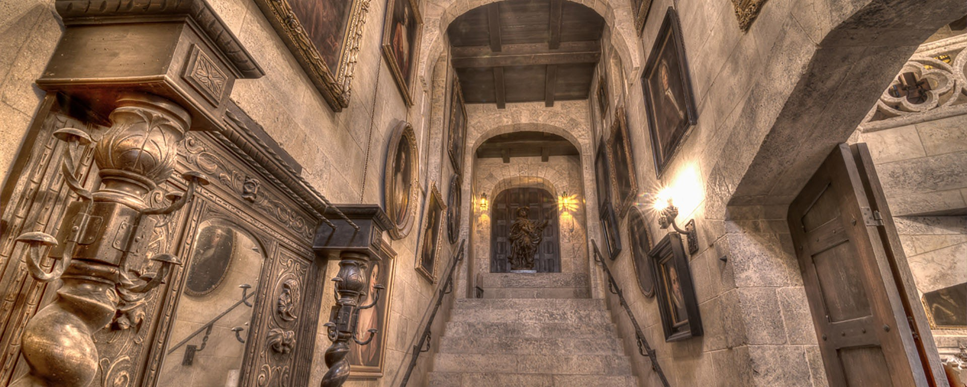 Gothic Medieval Game of Thrones style castle entrance with reclaimed limestone stair steps flooring wall cladding roman arches and rustic wood