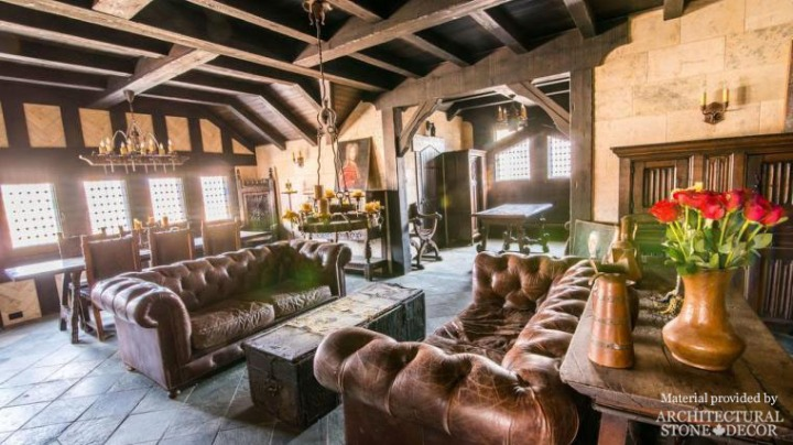 Gothic Medieval rustic living room reclaimed limestone wall cladding wood beams
