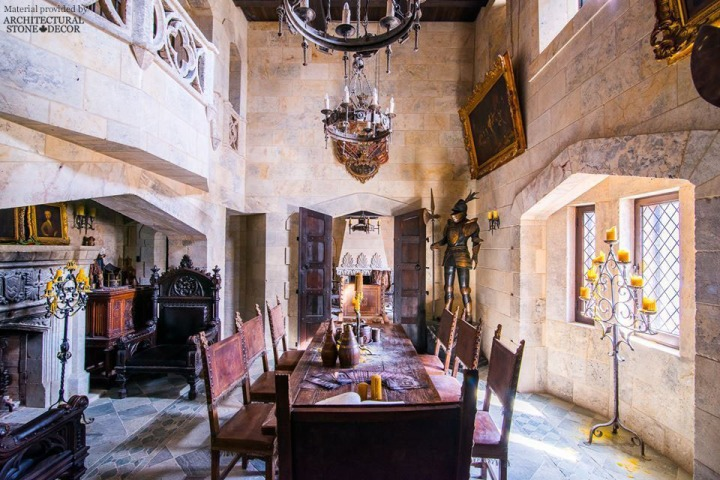 medieval game of thrones armor suit paintings reclaimed limestone wall cladding flooring fireplace balustrades rustic wood chandeliers