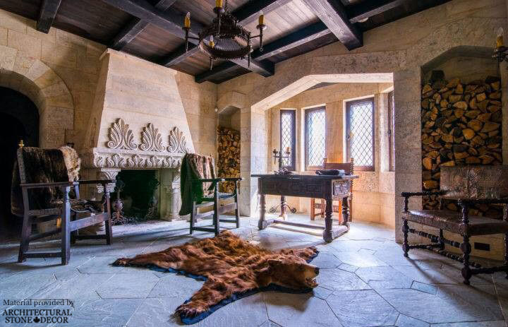 Gothic Medieval interior game of thrones reclaimed limestone rustic wood wrought iron furniture bear rug