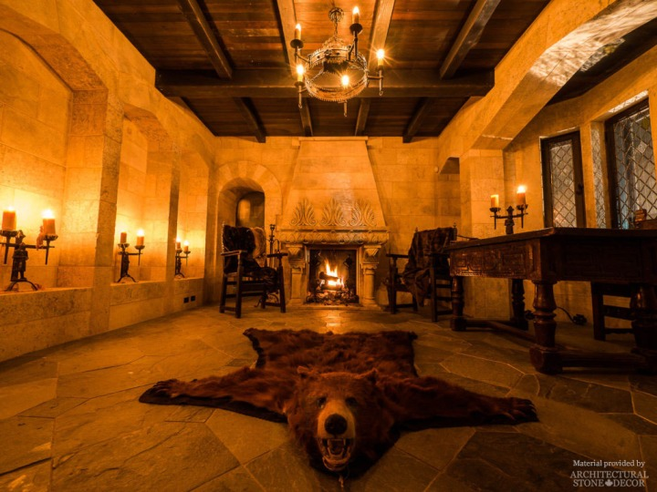 Gothic Medieval interior game of thrones style rustic limestone fireplace wall cladding wood beams
