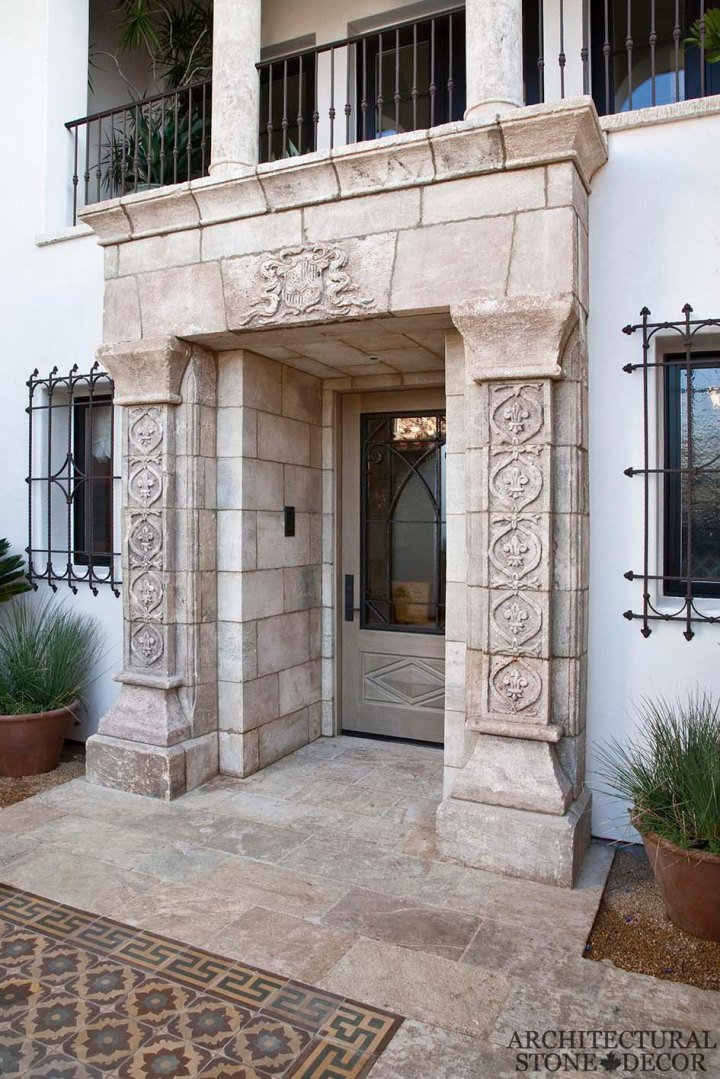 Game of Thrones Medieval Gothic hand carved reclaimed limestone entryway and reclaimed 'Barre Montpelier' limestone flooring colored french tiles