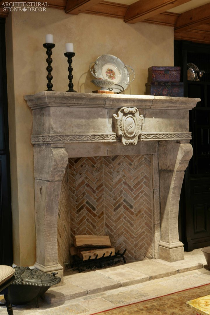 Medieval Gothic Game of Thrones interior style reclaimed ancient rustic hand carved limestone fireplace mantel
