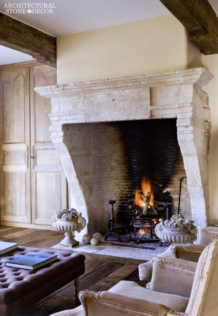 Medieval Gothic Game of Thrones interior style reclaimed ancient rustic hand carved limestone fireplace mantel brick firebox