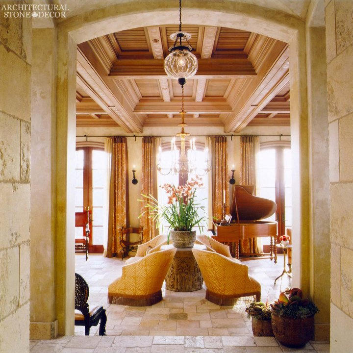 Game of Thrones Dorne Medieval Gothic reclaimed limestone 'Dalle de Bourgogne' flooring and wall cladding and corners exposed wood ceiling shutters column roman cap as table base
