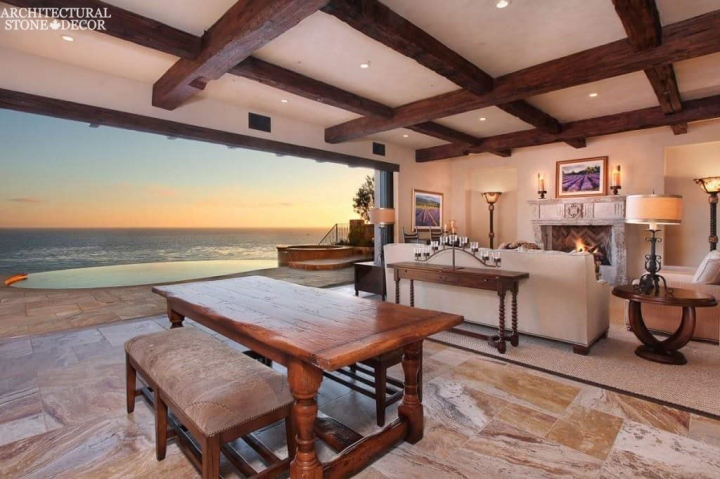 beach style living room reclaimed antique salvaged hand carved limestone natural stone fireplace mantel wood ceiling beams private poolcanada UK Australia