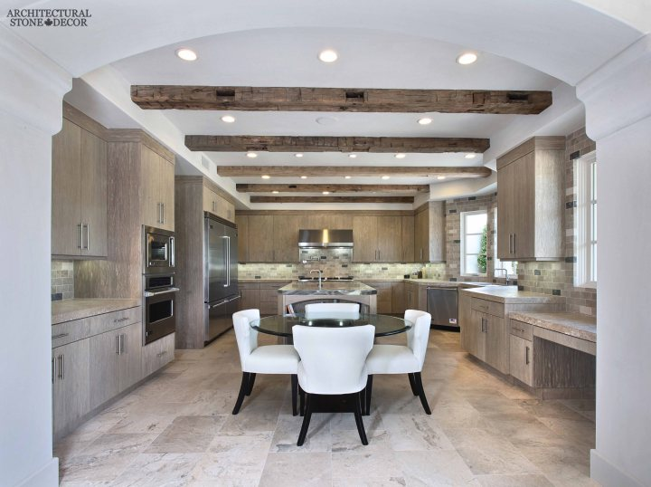 neolithic modern old world Barre Blonde reclaimed salvaged antique limestone flooring tiles running bond exposed ceiling wood beams butcher block counter tops modern kitchen canada Toronto Vancouver