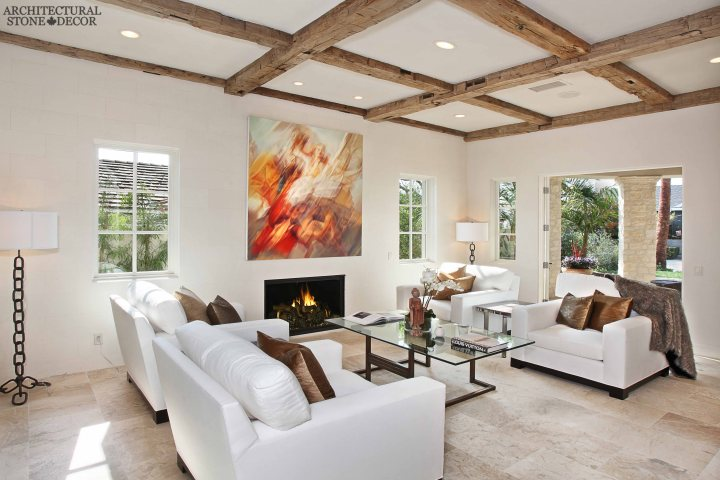 old world Barre Blonde reclaimed salvaged antique limestone flooring tiles running bond exposed ceiling wood beams modern living room canada toronto