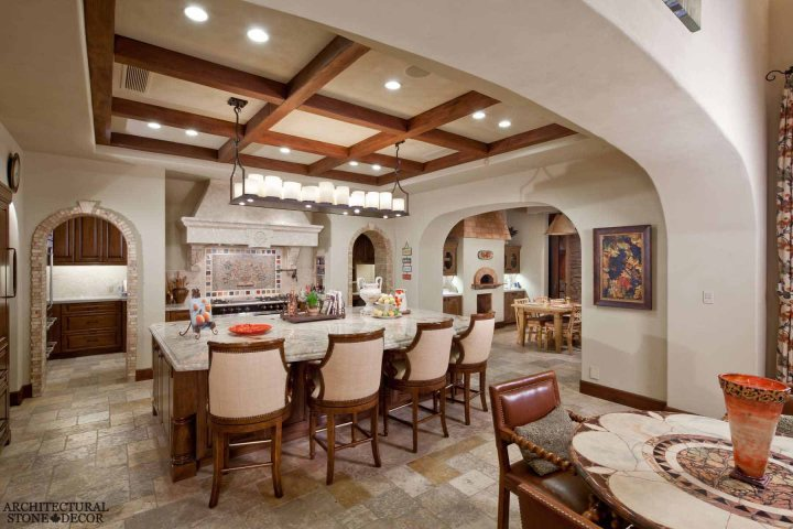 French provincial kitchen hand carved kitchen hood natural stone archways Barre Gray reclaimed salvaged antique limestone flooring Versailles pattern stone pavers tiles Canada Toronto