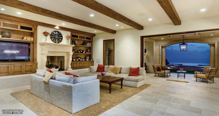 beach style living room reclaimed antique salvaged hand carved limestone natural stone fireplace mantel 'Barre Montpelier' flooring stone roman columns wood ceiling beams canada UK Australia