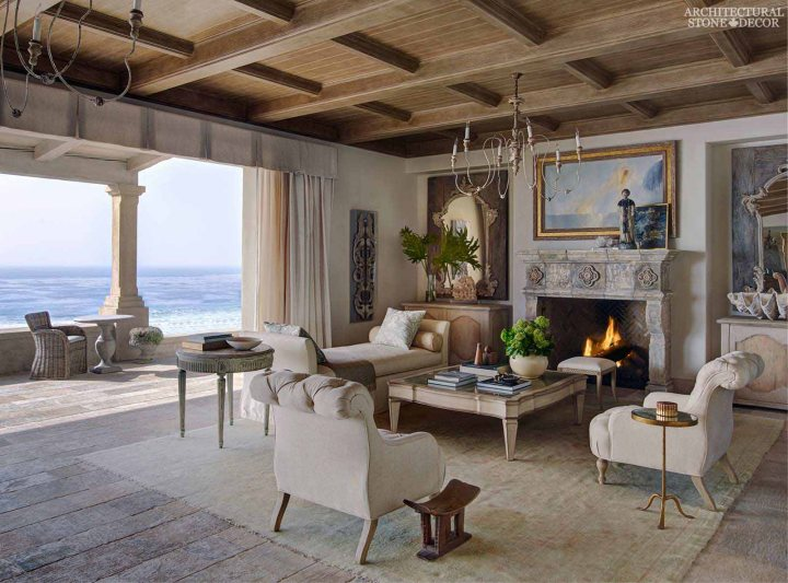 Mediterranean coastal style living room hand carved firepalce mantel Barre Montpelier reclaimed salvaged antique limestone flooring stone pavers Canada
