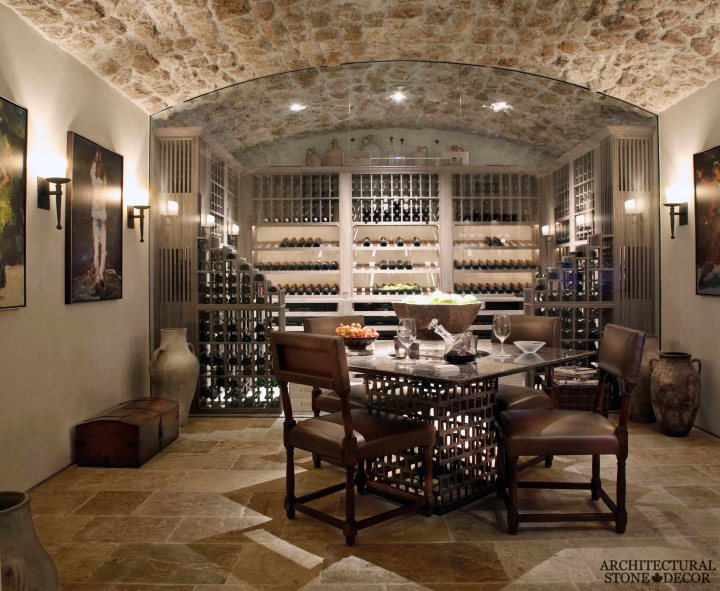 Tuscan style wine cellar/ tasting room cheese and wine Tuscan wall cladding ceiling Barre Montpelier reclaimed salvaged antique limestone flooring stone pavers BC Vancouver Canada