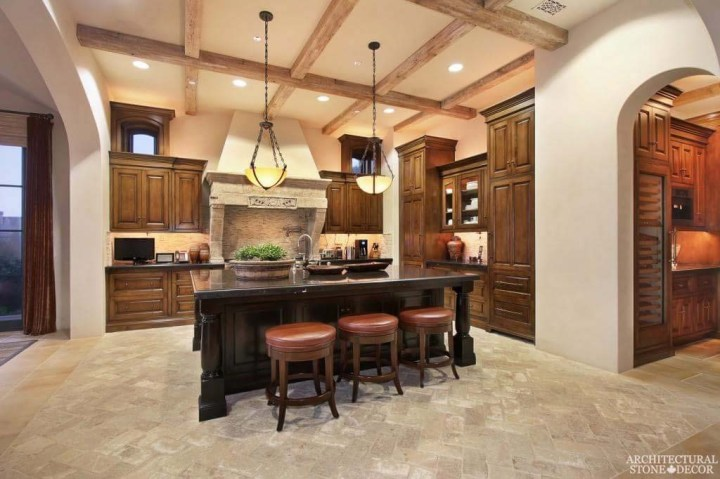 Canada Vancouver Mediterranean style hand carved salvaged natural stone kitchen hood Herring bone installation reclaimed French limestone Dalle de Bourgogne flooring
