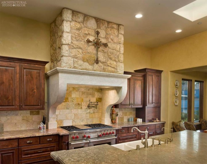 Country style kitchen hand carved reclaimed limestone kitchen hood French Dalle de bourgogne limestone wall cladding Tuscan wall cladding Canada