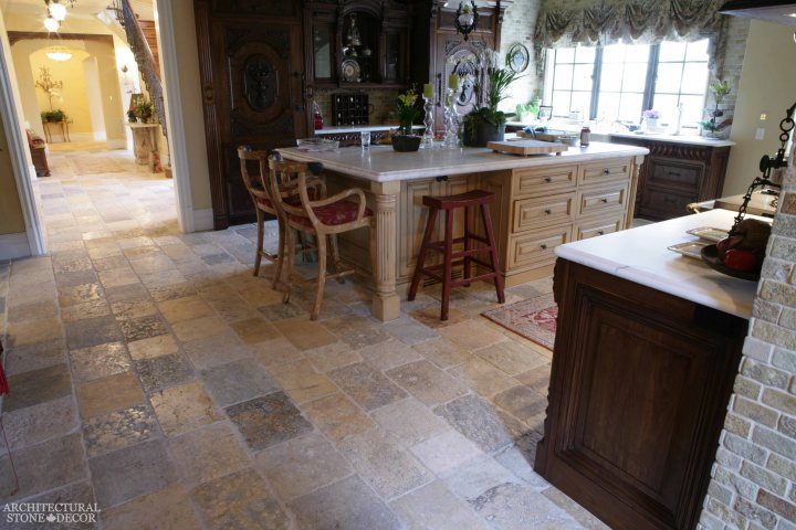 English style open kitchen area Dalle de Bourgogne reclaimed salvaged antique limestone flooring tiles running bond rough finish Canada