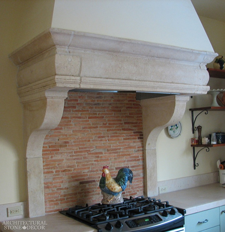 French country kitchen hood reclaimed antique hand carved limestone salvaged bricks backsplashCanada Prince Edward Island