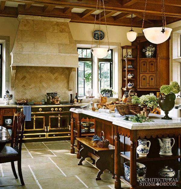 French country style reclaimed natrual stone hand carved kitchen hood Dalle de Bourgogne herring bone formation backsplash Barre Blonde flooring Canada