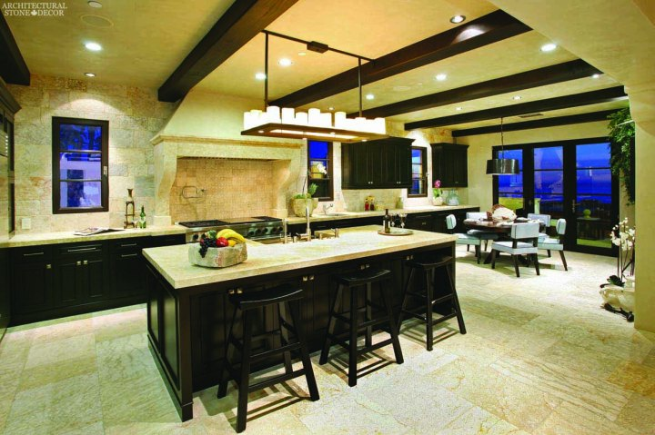 Mediterranean Kitchen reclaimed limestone Barre blonde flooring Barre Montpelier wall cladding backsplash butcher block counter tops hand carved kitchen hood Canada