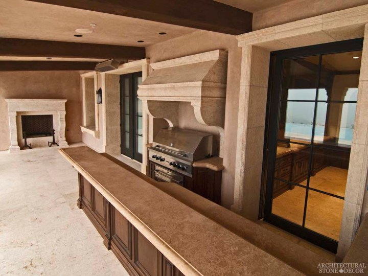 Rustic natural stone outdoor kitchen hood butcher block counter tops reclaimed limestone entryway window sills hand carved fireplace mantel Barre Blonde flooring Canada
