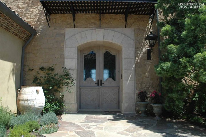 Coastal Mediterranean style hand carved limestone entryway Ontario Canada Vancouver British columbia Alberta Toronto home design
