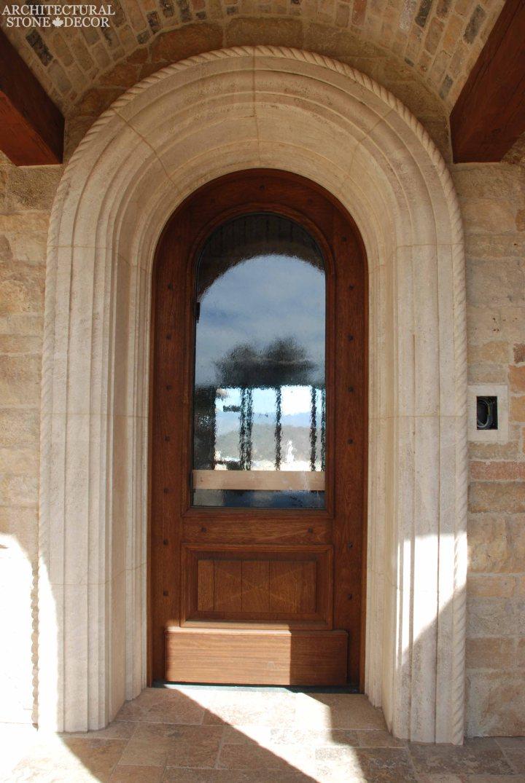 Coastal Mediterranean style hand carved limestone entryway Ontario Canada Vancouver British columbia home design