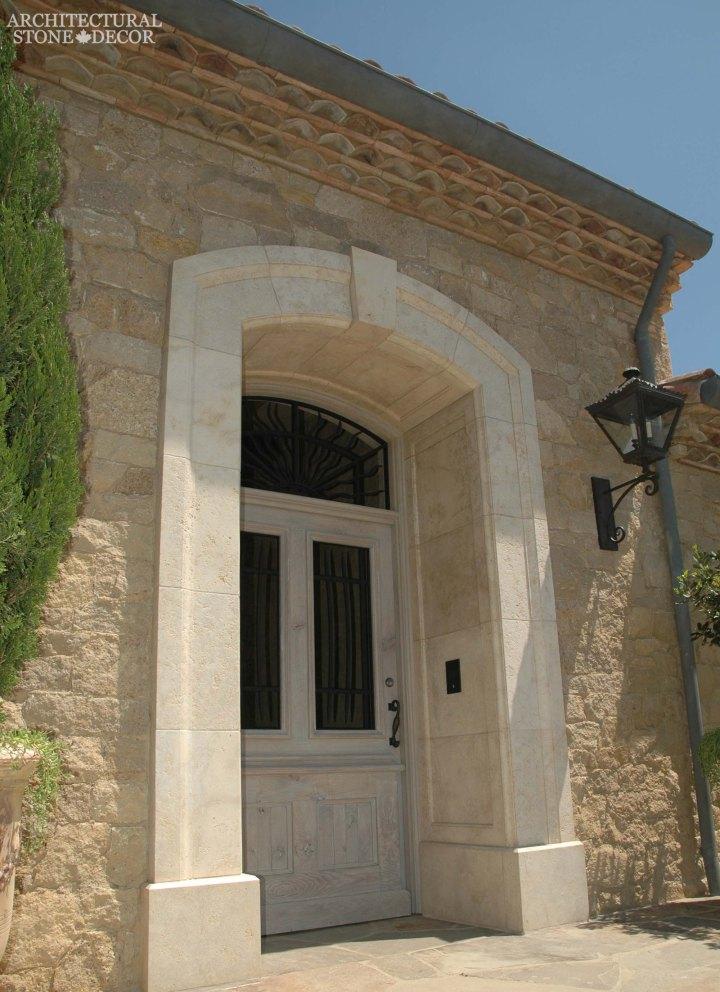 Coastal Mediterranean style hand carved limestone entryway Ontario Canada Vancouver British columbia Ottawa home design