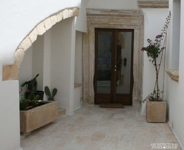 Cycladic Greek style minimalist interior home design french limestone entryway reclaimed archway Dalle de bourgogne antique french stone flooring tiles trough planters Canada
