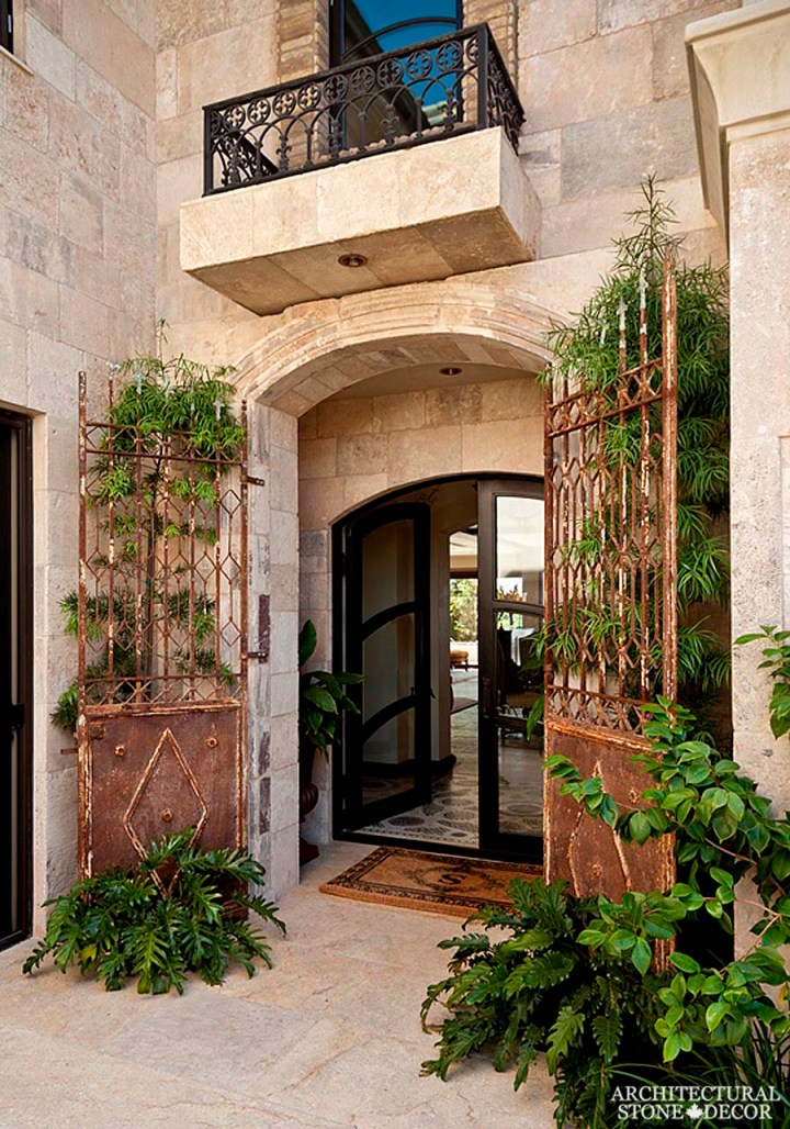 Tuscan Mediterranean style villa antique limestone entryway French stone Dalle de Bourgogne flooring Barre Montpelier wall cladding wrought iron and balcony railing and gate Toronto