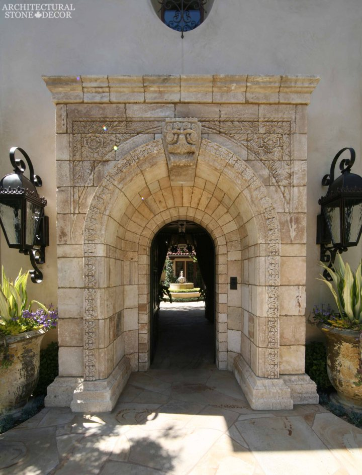 Tuscan style arched entryway heavily carved reclaimed limestone entrance old world look Canada Ontario Toronto
