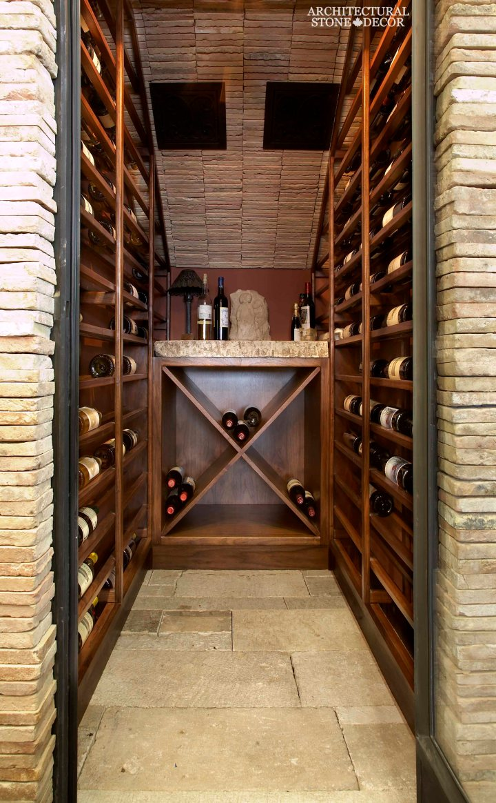 Antique Rustic Old world wine cellar salvaged reclaimed limestone ceiling and flooring entryway wood wine racks natural stone butcher block countertop