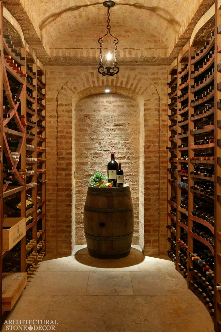 Antique Rustic Old world wine cellar salvaged reclaimed limestone ceiling and flooring wall cladding wood wine bottle rack wine barrel