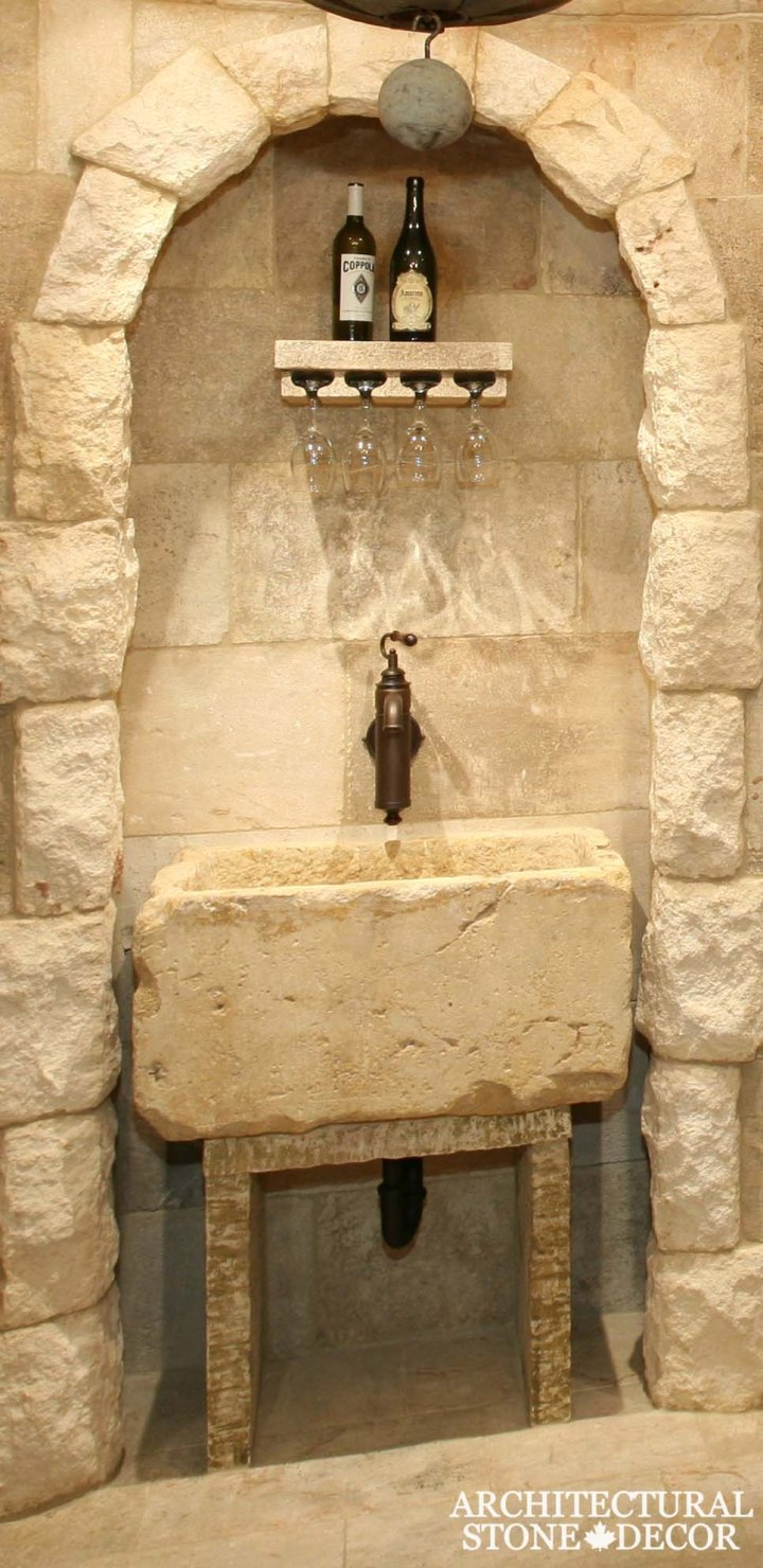 Rustic reclaimed salvaged hand carved natural stone limestone wall cladding arch flooring wine glass holder shelf table trough toronto canada