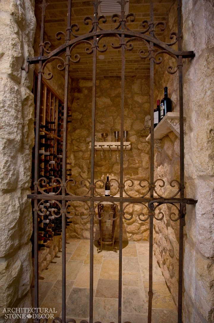 Rustic reclaimed salvaged old natural stone hand carved limestone flooring wall cladding ceiling table shelf wine glass holders wrought iron gate