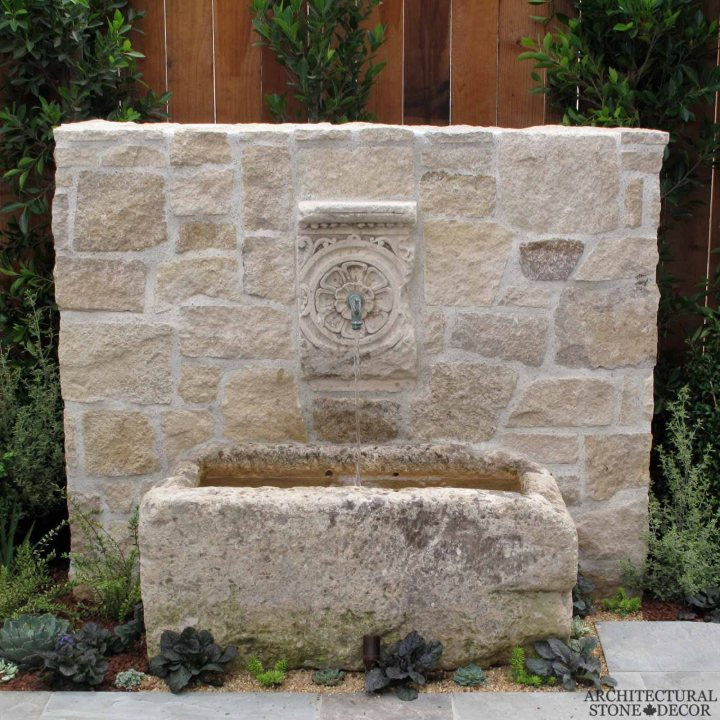 Mediterranean antique old rustic reclaimed old world natural stone hand carved limestone exterior outdoor water wall fountain garden design ideas landscape