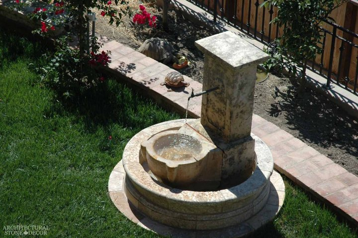 coastal mediterranean antique old rustic reclaimed old world natural stone hand carved limestone exterior outdoor water wall fountain garden design ideas landscape