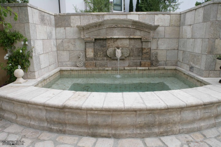 Tuscan style antique old rustic reclaimed old world natural stone hand carved limestone exterior outdoor water wall fountain garden design ideas landscape