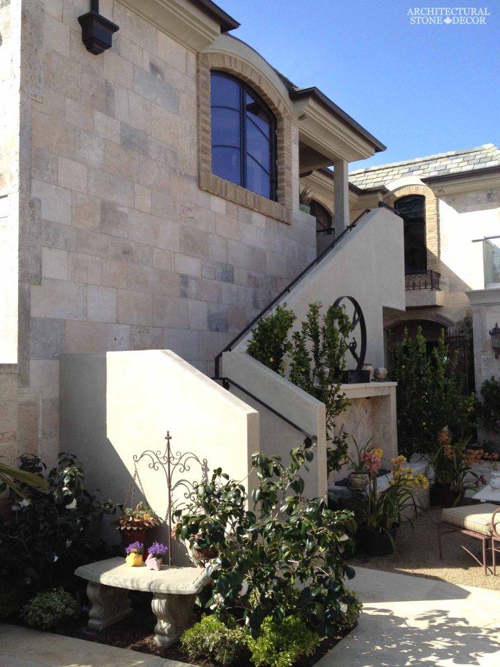 Tuscan Mediterranean style villa Outdoor Exterior natural stone reclaimed rustic old world limestone wall cladding veneer Canada ca