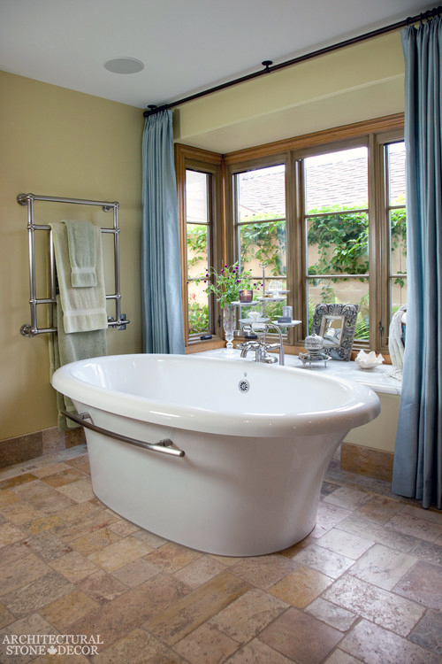 French country style master bathroom reclaimed antiqued limestone natural stone flooring modern canada ca