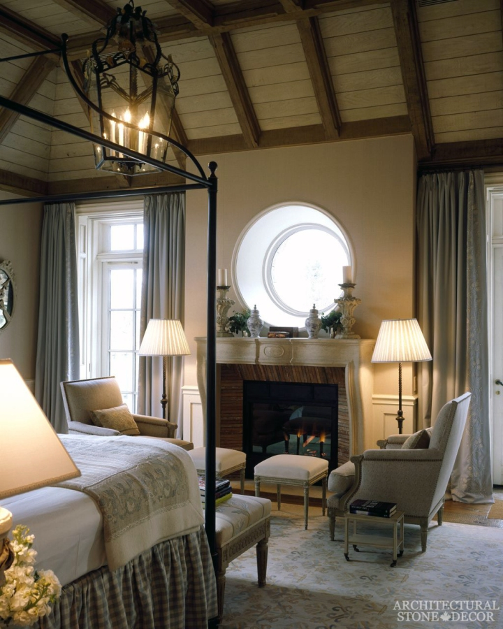 French country style master bedroom natural reclaimed antiqued limestone stone fireplace mantel canada ca