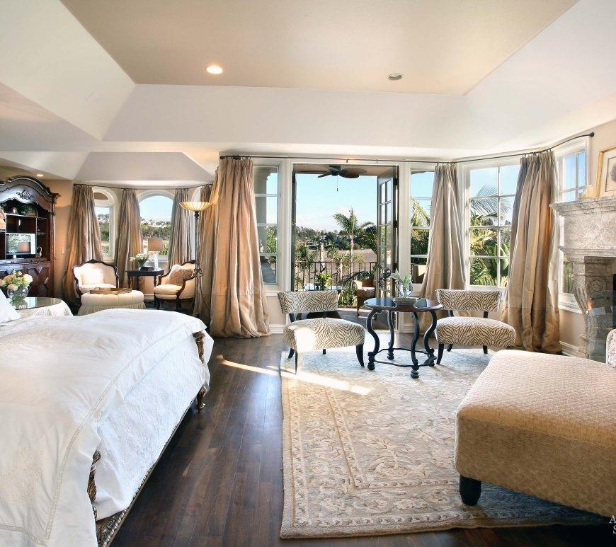 west coast style coastal mediterranean master bedroom limestone handcarved reclaimed antiqued fireplace mantel cladding Canada