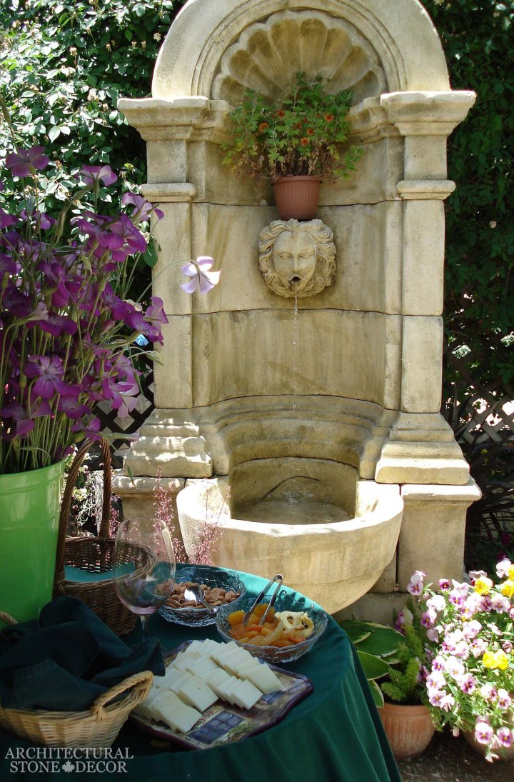 Mediterranean style garden backyard reclaimed rustic old natural stone limestone hand carved wall fountain canada ca Toronto BC