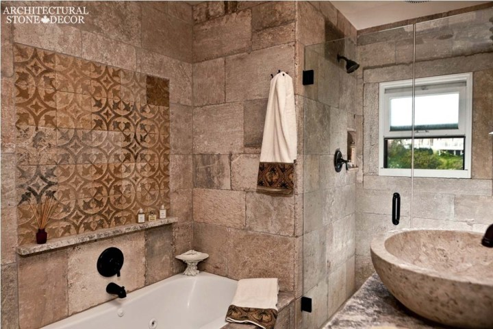 Mediterranean style master bathroom reclaimed rustic old natural stone limestone wall cladding hand carved sink shower cladding canada ca Toronto BC