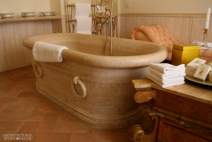 Mediterranean style bathroom reclaimed rustic old natural stone limestone hand carved bathtub canada ca Toronto BC