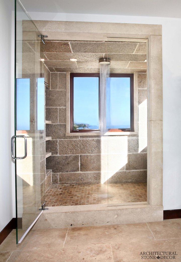 Mediterranean style bathroom reclaimed rustic old natural stone limestone wall cladding hand carved shower cladding surround canada ca Toronto BC